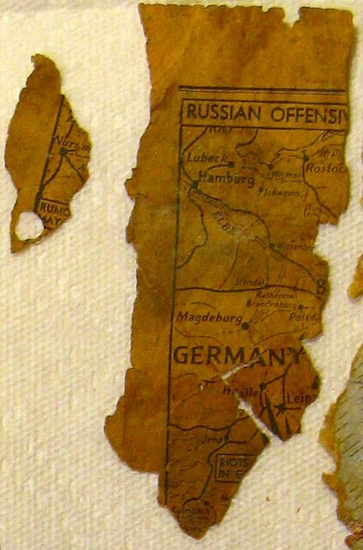 1940s newspaper, map of the German-Russian border, stuffed in crack between fireplace and wall