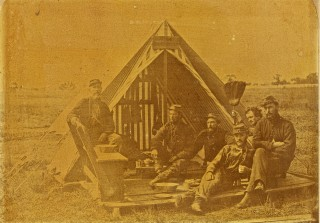 **Not my photo** - see www.washingtonartillery.com - 5th Co, Washington Artillery in the field, Camp Lewis(now Audubon Park), striped tent made of circus tent canvas