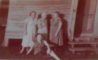 ca.1948, Yola(37), Tante SIn(83), unknown, and Geraldine seated(16), the year Tante Sin died, outside the back bedroom.