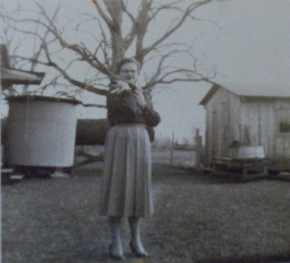 Adeo's house, cistern at back of house and pecan tree in background,1950s-early 60s