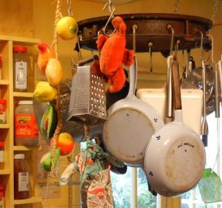 1800s sugar cane wagon wheel rim as pot rack