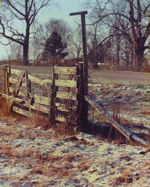 old cypress gate in the snow of 1989, Cajun sugar cane farm in 1800s Breaux Bridge